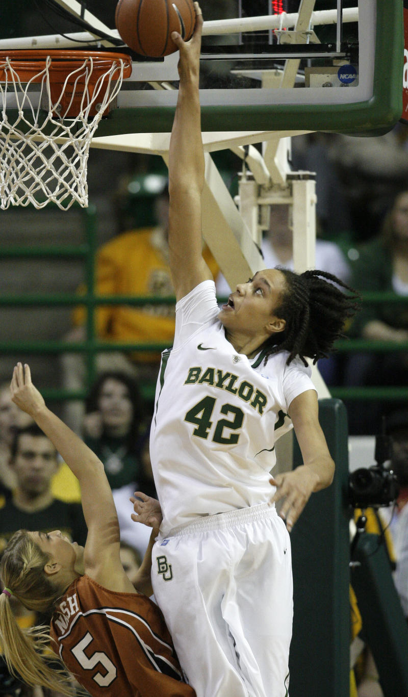Texas' Kathleen Nash (5) attempts to defend against a shot by Baylor's Brittney Griner (42) in the first half of an NCAA basketball game Saturday, Feb. 12, 2011, in Waco, Texas.  (AP Photo/Tony Gutierrez)
