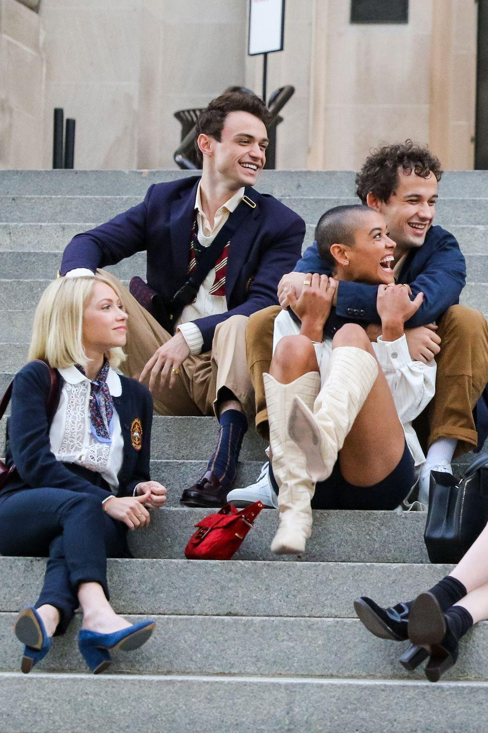 <p>Tavi Gevinson (bottom left) is spotted with the crew in a cardigan, white blouse, tapered pants, and blue velvet block-heeled pumps. </p>