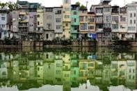 Hanoi's tree-lined streets are packed with dwellings that are barely four metres wide, but three times that in depth