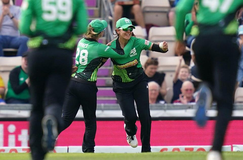 Southern Brave's Maia Bouchier (right) celebrates catching Oval Invincibles' Georgia Adams during The Hundred match at The Ageas Bowl, Southampton. Picture date: Monday August 16, 2021. (PA Wire)