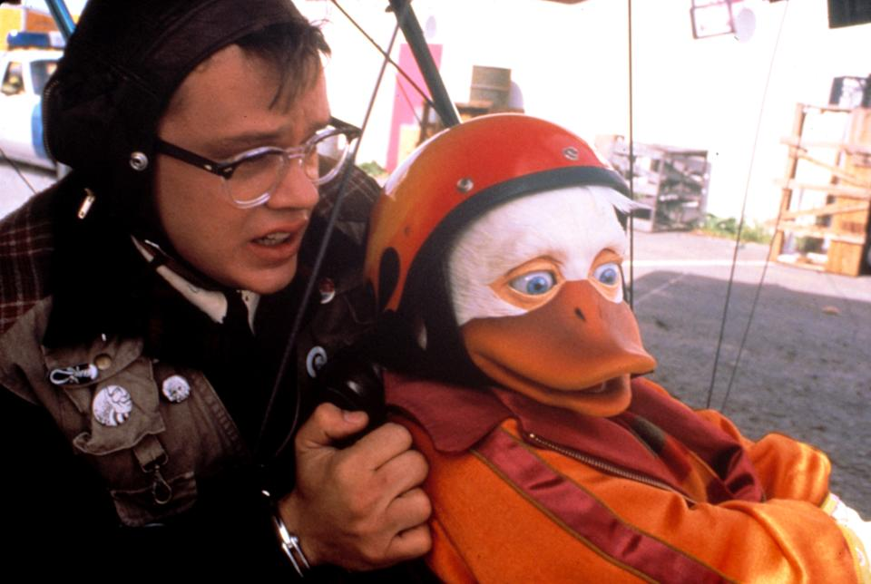 Tim Robbins and the title character of the notorious 1986 bomb, Howard the Duck, which is celebrating its 35th anniversary. (Photo: Universal Pictures/ Courtesy: Everett Collection.)