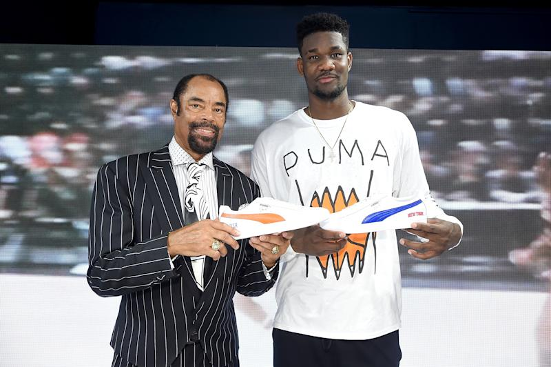 """BROOKLYN, NY - JUNE 18: Walt """"Clyde"""" Frazier and Deandre Ayton attend the PUMA Hoops HQ kickoff where Walt """"Clyde"""" Frazier signs the first ever life long contract with PUMA on June 18, 2018 in Brooklyn. (Photo by Jamie McCarthy/Getty Images for PUMA)"""