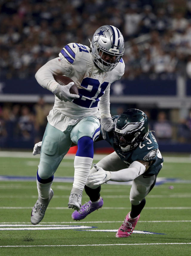 Dallas Cowboys running back Ezekiel Elliott (21) runs the ball as Philadelphia Eagles free safety Rodney McLeod (23) attempts the stop in the first half of an NFL football game in Arlington, Texas, Sunday, Oct. 20, 2019. (AP Photo/Ron Jenkins)