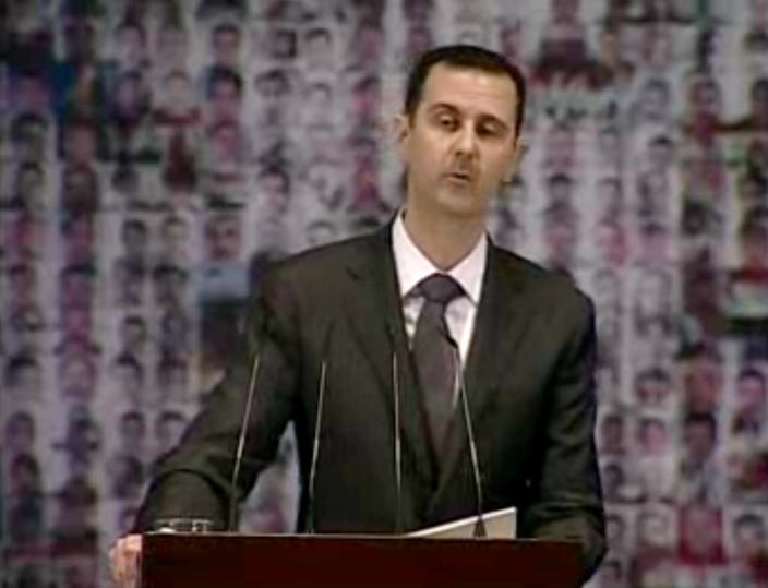 In this image taken from video obtained from Syrian State Television, which has been authenticated based on its contents and other AP reporting, Syrian President Bashar Assad speaks at the Opera House in central Damascus, Syria, Sunday, Jan. 6, 2013. Syrian President Bashar Assad on Sunday outlined a new peace initiative that includes a national reconciliation conference and a new government and constitution but demanded regional and Western countries stop funding and arming rebels first. (AP Photo/Syrian State Television via AP video)