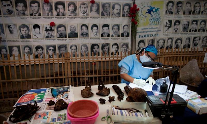 A forensic anthropologist analyses exhumed bones removed from a mass grave in La Verbena cemetery.