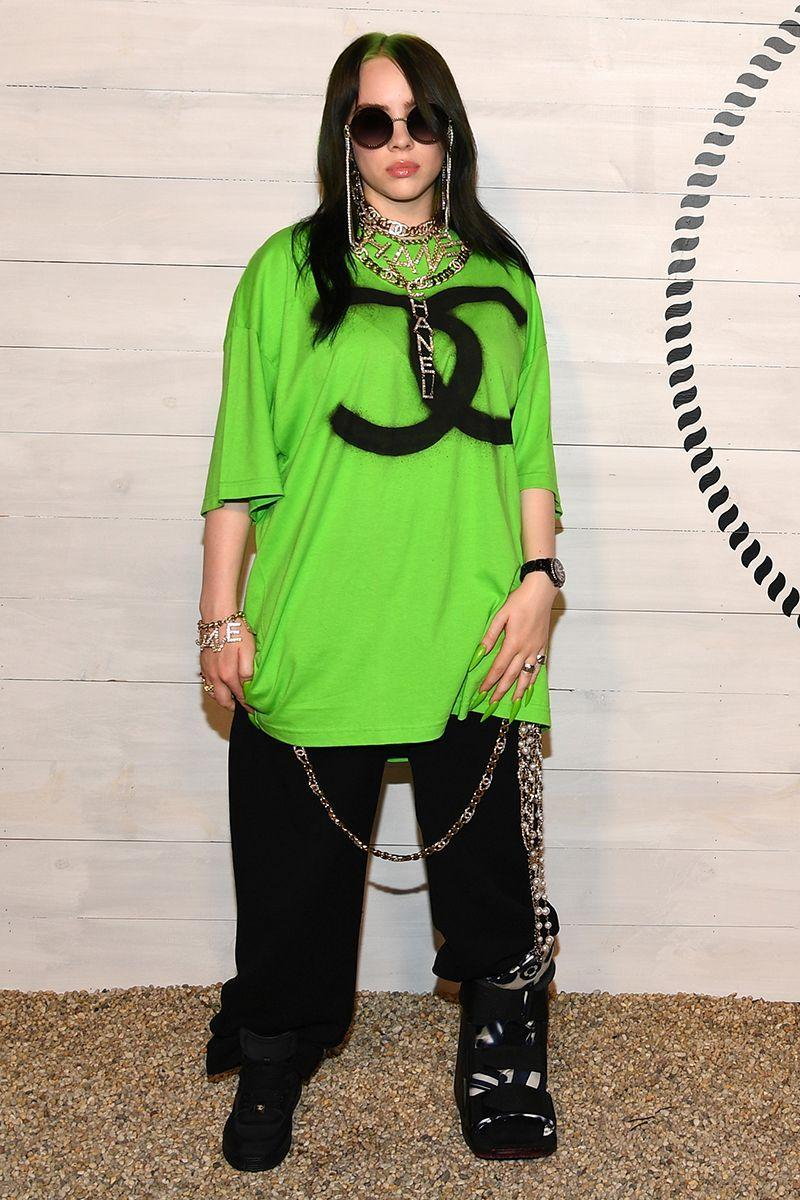 <p>Billie wears her signature slime green and black combo at a Chanel dinner. Filed under: how to make an ankle brace look cool.</p>