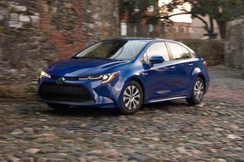 This undated photo provided by Toyota shows the 2020 Toyota Corolla Hybrid sedan. Car shoppers seeking high fuel economy have two particularly intriguing choices this year: the Honda Insight and the Toyota Corolla Hybrid. Both deliver an EPA-estimated 52 mpg in combined city and highway driving, which is among the best of any vehicle on sale.  (Toyota via AP)