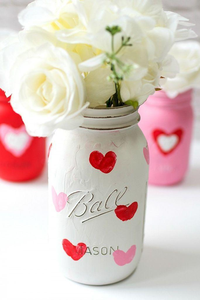 """<p>Here's a cute idea: Have your partner lend their thumbprint to half of each of the painted hearts on this Mason jar!</p><p><strong>Get the tutorial at <a href=""""https://www.itallstartedwithpaint.com/valentine-kid-craft-thumbprint-heart-jars/"""" rel=""""nofollow noopener"""" target=""""_blank"""" data-ylk=""""slk:It All Started With Paint"""" class=""""link rapid-noclick-resp"""">It All Started With Paint</a>.</strong></p><p><strong><a class=""""link rapid-noclick-resp"""" href=""""https://www.amazon.com/Ball-Mason-Jar-32-Collection-Heritage/dp/B075DLJJDD?tag=syn-yahoo-20&ascsubtag=%5Bartid%7C10050.g.2971%5Bsrc%7Cyahoo-us"""" rel=""""nofollow noopener"""" target=""""_blank"""" data-ylk=""""slk:SHOP MASON JARS"""">SHOP MASON JARS</a><br></strong></p>"""