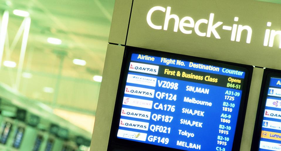 An international flight check-in board is seen at Sydney Airport.
