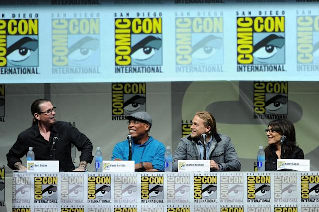 "SAN DIEGO, CA - JULY 21: (L-R) Writer/producer Kurt Sutter, director/producer Paris Barclay and actors Charlie Hunnam and Katey Sagal speak onstage at the ""Sons Of Anarchy"" panel during Comic-Con International 2013 at San Diego Convention Center on July 21, 2013 in San Diego, California. (Photo by Kevin Winter/Getty Images)"