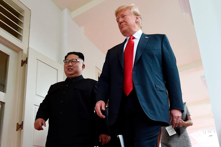 Kim walks beside Trump at the start of the summit.