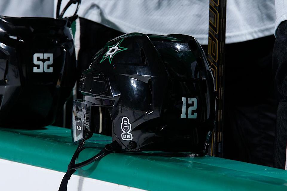 DALLAS, TX – OCTOBER 22: Special stickers are worn on the back of the Dallas Stars helmets to honor Dallas Stars play-by-play announcer Dave Strader who is currently locked in a battle with cancer before a game against the Columbus Blue Jackets at the American Airlines Center on October 22, 2016 in Dallas, Texas. (Photo by Glenn James/NHLI via Getty Images)