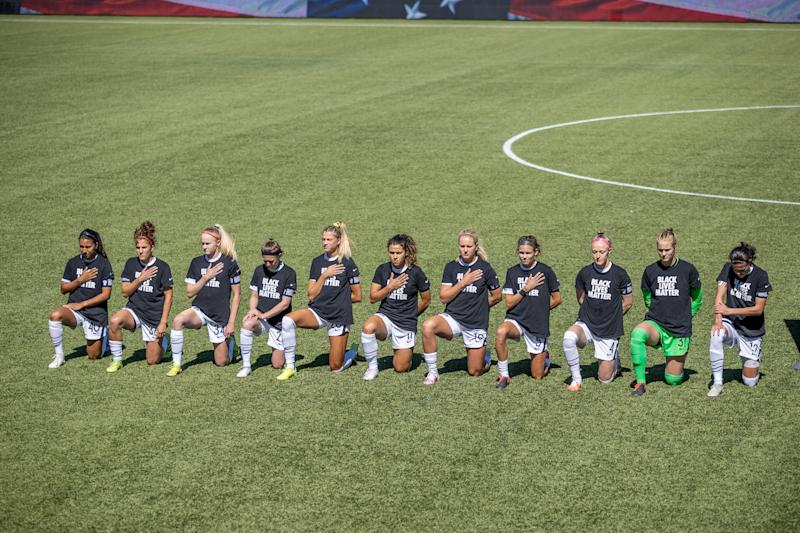HERRIMAN, UT - JUNE 27: Portland Thorns FC starting XI take a knee before a game between Portland Thorns FC and North Carolina Courage at Zions Bank Stadium on June 27, 2020 in Herriman, UT, Utah. (Photo by Bryan Byerly/ISI Photos/Getty Images)