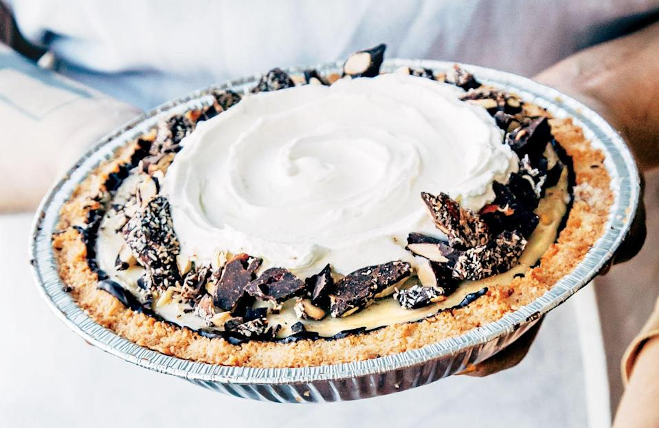 """Tandem Coffee + Bakery's coconut cream pie recipe riffs on the classic in all the right ways. Shredded coconut is a genius swap-in for cookie crumbs in the crust, and incorporating both coconut and regular milks in the custard gives it better flavor and a fluffier consistency. <a href=""""https://www.bonappetit.com/recipe/coconut-cream-pie-macaroon-press-crust?mbid=synd_yahoo_rss"""" rel=""""nofollow noopener"""" target=""""_blank"""" data-ylk=""""slk:See recipe."""" class=""""link rapid-noclick-resp"""">See recipe.</a>"""