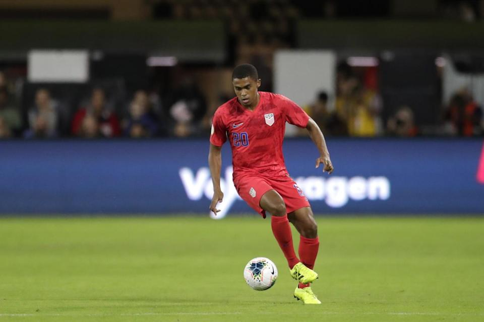 The United States' Reggie Cannon dribbles the ball