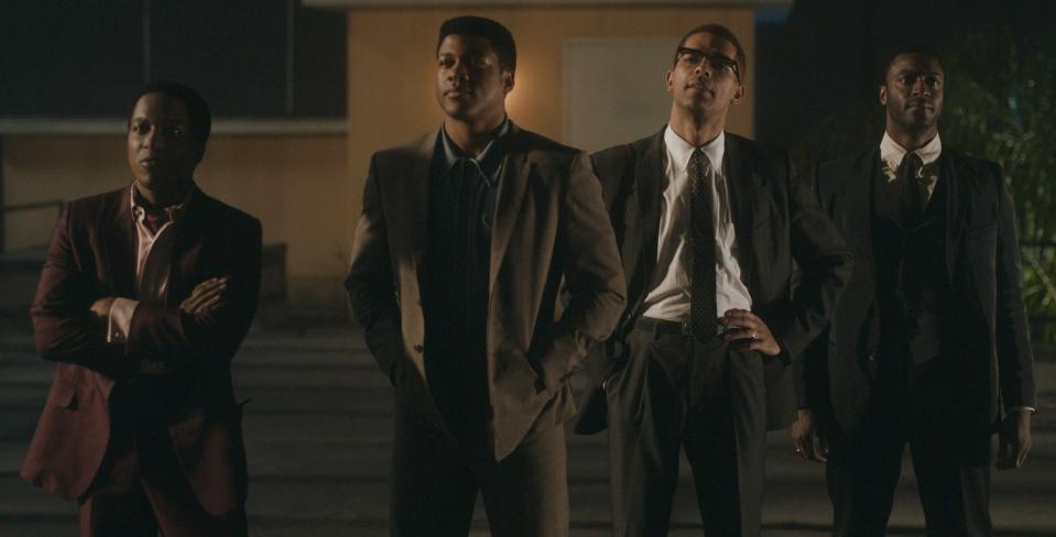"""This image released by Amazon Studios shows Leslie Odom Jr., from left, Eli Goree, Kingsley Ben-Adir and Aldis Hodge in a scene from """"One Night in Miami,"""" named one of the top 10 films of the year by The American Film Institute. (Amazon Studios via AP)"""