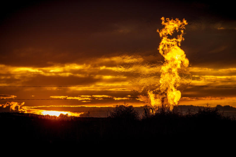 Flames from a flaring pit near a well in the Bakken oil field, which spans Montana, North Dakota and parts of Canada. The primary component of natural gas is methane. (Orjan F. Ellingvag via Getty Images)