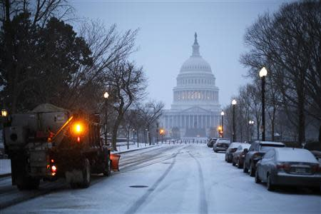 A general view of the U.S. Capitol in early morning snow in Washington, March 3, 2014. REUTERS/Jonathan Ernst