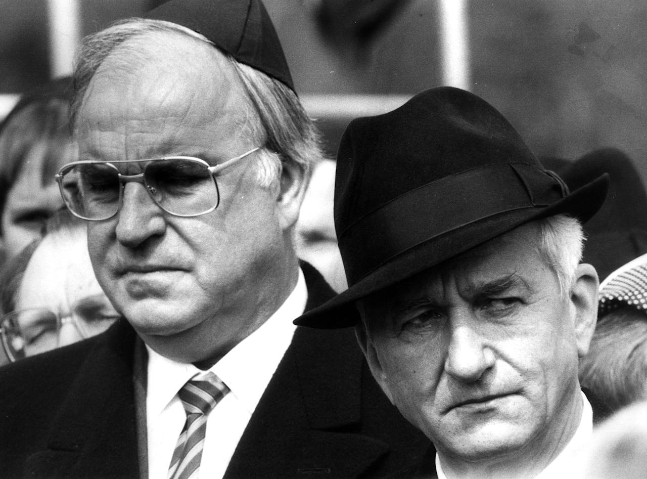 <p>Helmut Kohl stands with former West German President Richard von Weizsaecker (R) in this April 21 1985 file photo during a memorial ceremony marking the 40th anniversary of the liberation of the former Bergen Belsen concentration camp, April 21, 1985. (Ulli Michel/Reuters) </p>