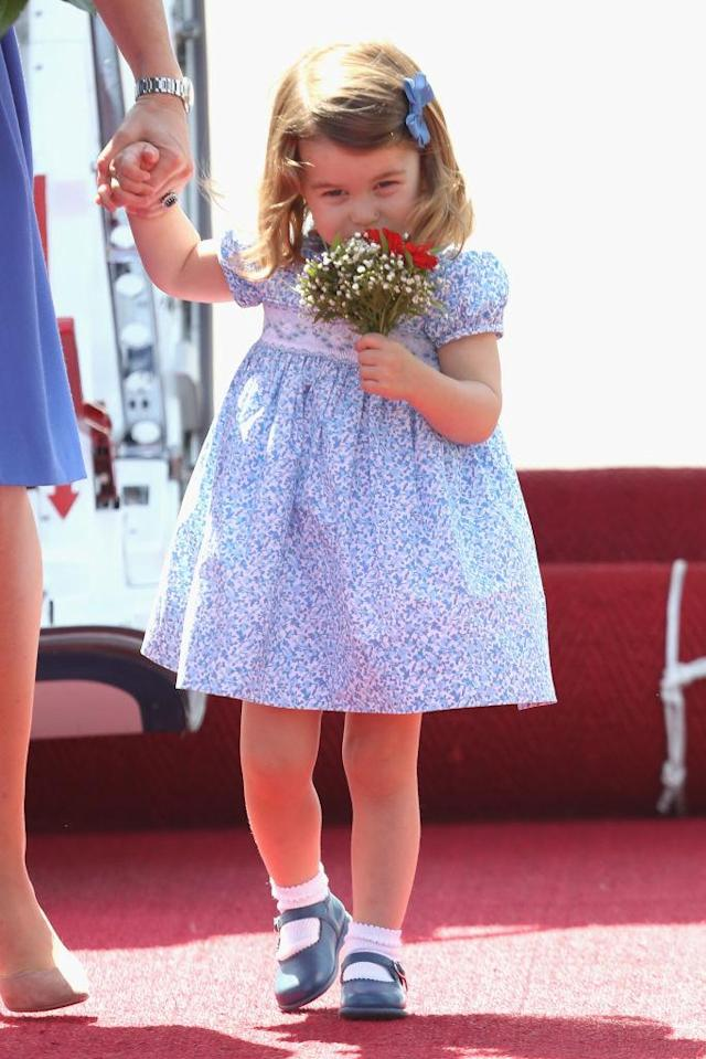 <p>Arriving at Berlin airport on July 19, 2017, Princess Charlotte made her debut tour memorable. The toddler stepped out in a dainty printed dress and coordinating shoes. (Photo: Getty Images) </p>