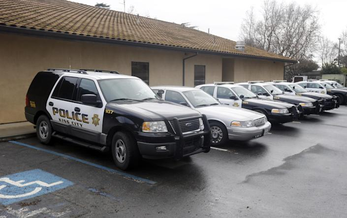 Patrol cars are lined up at the King City Police Deptment on Wednesday, Feb. 26, 2014, in King City, Calif. The acting police chief and two officers in King City were removed from duty after being arrested on suspicion of selling or giving away the impounded cars of poor residents, authorities said. (AP Photo/Marcio Jose Sanchez)