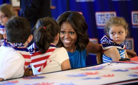 Michelle Obama greets children during a visit to the newly opened USO Warrior and Family Center at Fort Belvoir