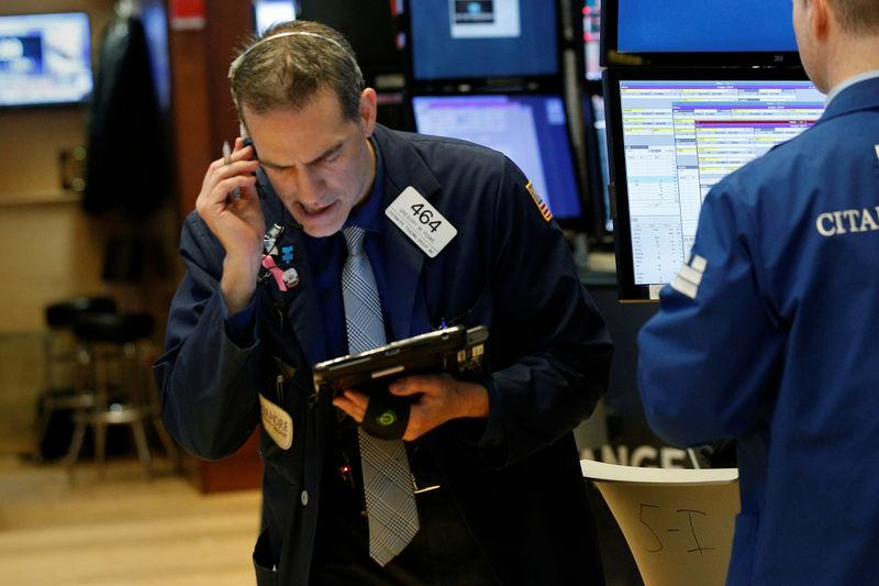 Traders work on the floor of the New York Stock Exchange in the Manhattan borough of New York City