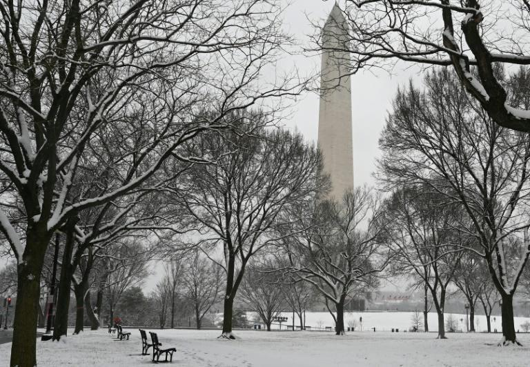 The Washington Monument is seen from the snow-covered National Mall in Washington, DC on January 31, 2021 as the capital region is under a winter storm warning for an expected five or more inches (12.7 centimeters) of snow