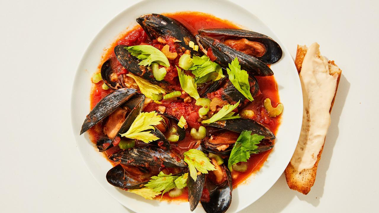 "Mussels are a steal compared to most fresh seafood options, and cook in practically no time at all—a weeknight dinner dream. Be sure to buy rope-grown mussels, which require a lot less cleaning and are virtually free of grit, and always check each individual bivalve to make sure it's closed tightly before cooking—it's a little tedious, but one dead mussel will ruin the whole pot. <a href=""https://www.bonappetit.com/recipe/mussels-in-spicy-tomato-broth?mbid=synd_yahoo_rss"">See recipe.</a>"