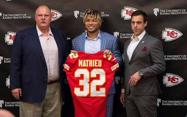 Tyrann Mathieu, coach Andy Reid, left, and general manager Brett Veach, right, signed with the Chiefs in March. (AP)