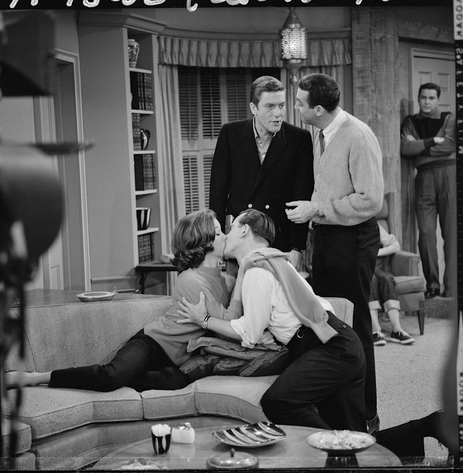 "LOS ANGELES - NOVEMBER 13: THE DICK VAN DYKE SHOW. Episode:  ""Somebody Has to Play Cleopatra."" Featuring (from left):  Mary Tyler Moore (as Laura Petrie), Bob Crane (as Harry Rodgers), Dick Van Dyke (as Rob Petrie), and Jerry Paris (as Jerry Helper). Image dated November 13, 1962. (Photo by CBS via Getty Images)"
