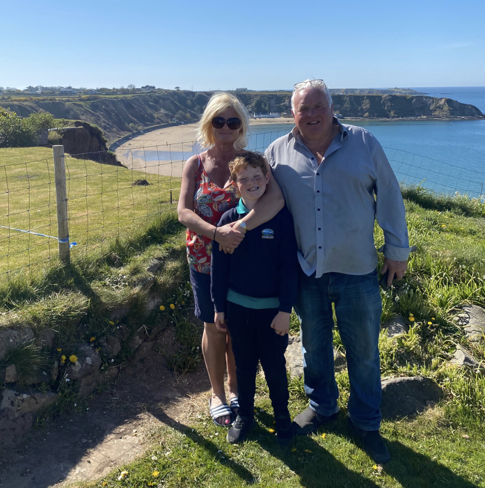 Hotel owner Melvyn Jones, whose house backs onto the landslide, with wife Paula and son Harri. (Yahoo UK/Courtesy of the Jones family)