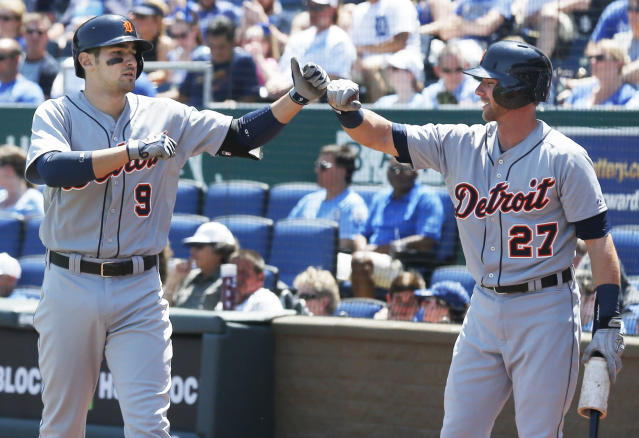 Detroit Tigers' Nick Castellanos (9) is congratulated by on-deck batter Andrew Romine (27) following a solo home run during the second inning of a baseball game against the Kansas City Royals in Kansas City, Mo., Sunday, May 4, 2014. (AP Photo/Orlin Wagner)