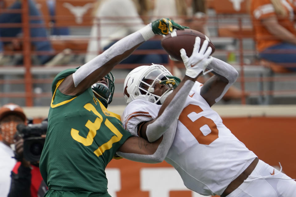 Baylor's Mark Milton (37) knocks the ball away from Texas' Joshua Moore (6) during the first half of an NCAA college football game in Austin, Texas, Saturday, Oct. 24, 2020. (AP Photo/Chuck Burton)