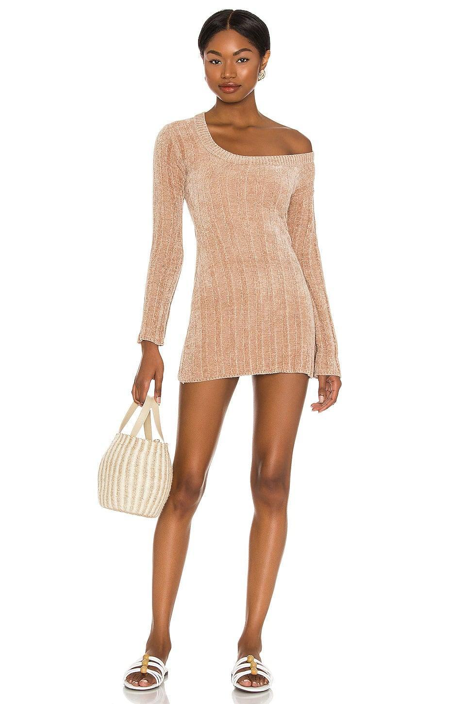 <p>Get into the fall spirit with this stunning <span>Majorelle Britta Chenille Mini Dress in Beige</span> ($35, originally $138). It's an off the shoulder mini dress that takes sweater dresses to a whole new level. </p>