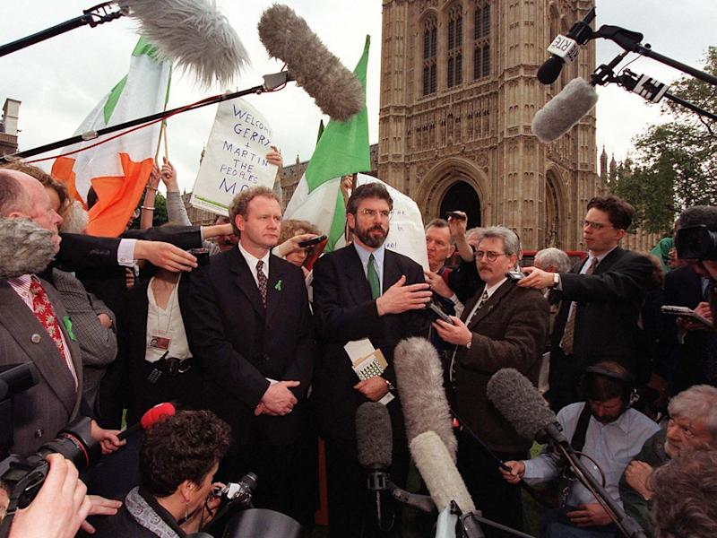 Newly elected Sinn Fein MPs McGuinness and Adams in May 1997 after challenging an order barring them from Parliament for refusing to swear allegiance to the Queen