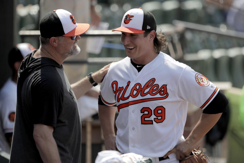 Baltimore Orioles starting pitcher Asher Wojciechowski, right, talks to pitching coach Doug Brocail in the dugout after being pulled from the mound during the eighth inning of a baseball game against the Baltimore Orioles, Sunday, July 21, 2019, in Baltimore. The Orioles won 5-0. (AP Photo/Julio Cortez)