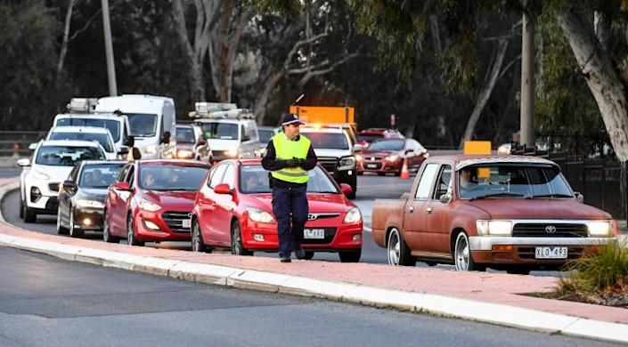 The decision to close the boundary between Victoria and New South Wales left residents of border towns scrambling to obtain permits to cross for work or other essential reasons, while school holiday travellers were rushing to return home (AFP Photo/William WEST)