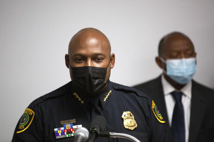 Houston Police Department Chief Troy Finner, with Houston Mayor Sylvester Turner, right, speaks during a press conference to provide updates on the investigation in the murder of off-duty New Orleans Police officer Everett Briscoe, Friday, Aug. 27, 2021, in Houston. HPD and the City of Houston announced the arrest of Anthony Jenkins and Frederick Jackson for their alleged involvement in the murder of the officer. (Marie D. De Jesús/Houston Chronicle via AP)