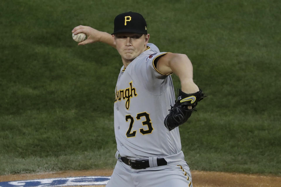 Pittsburgh Pirates starting pitcher Mitch Keller throws to a Chicago Cubs batter during the first inning of a baseball game in Chicago, Saturday, Aug. 1, 2020. (AP Photo/Nam Y. Huh)
