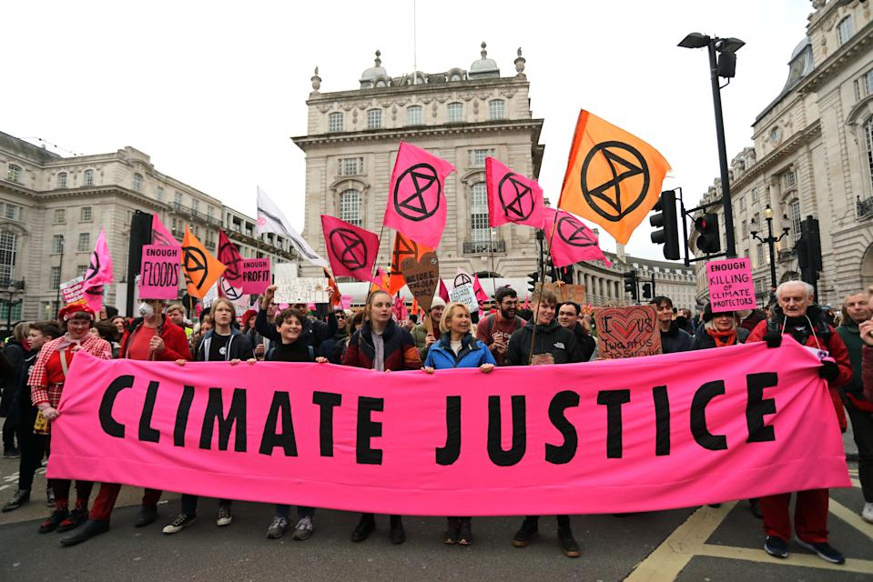 Protesters during an Extinction Rebellion (XR) march through Piccadilly Circus to Parliament Square in London.