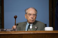 "Chairman Chuck Grassley, R-Iowa, holds up a gavel during a Senate Finance Committee hearing on ""COVID-19/Unemployment Insurance"" on Capitol Hill in Washington on Tuesday, June 9, 2020. (Caroline Brehman/CQ Roll Call/Pool via AP)"