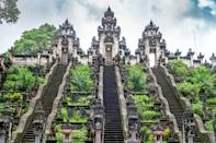 """<p><strong>What's this temple like?</strong><br> Located far from the tourist hubbub of <a href=""""https://www.cntraveler.com/story/finding-the-bali-you-came-for?mbid=synd_yahoo_rss"""" rel=""""nofollow noopener"""" target=""""_blank"""" data-ylk=""""slk:Ubud"""" class=""""link rapid-noclick-resp"""">Ubud</a>, Lempuyang Temple is a sacred seven-temple complex in eastern Bali best known for the Gateway to Heaven that perfectly frames formidable Mount Agung, the island's tallest peak. Entrance requires a donation, a sarong (also available on loan), and a 40,000 rupiah ($3) round-trip jeep shuttle up the steep mountainside—unless you're brazen enough to walk.</p> <p><strong>What's it like being there?</strong><br> Awe-inspiring.</p> <p><strong>Why do people make the trip here?</strong><br> Most travelers come to take epic Instagram photos in between the Gateway of Heaven before exploring other attractions in the remote region.</p> <p><strong>Does it live up to expectations??</strong><br> Set atop Mount Lempuyang, the Gateway of Heaven is mesmerizing—with a few caveats. First, arrive before 9 a.m. or you'll have to contend with tourists waiting to snap pictures. Then, be ready to hand over your camera to a designated cameraperson and confirm your poses in advance—you'll have just a few seconds for your shots. The other temples are also worth exploring, and you can easily spend two hours strolling the mountainous paths to see them all.</p> <p><strong>Why would you recommend making the time for this temple?</strong><br> This is one of the most majestic sights in Bali—come for sunrise to get the best, least crowded results—and it's also a significant Hindu temple.</p>"""