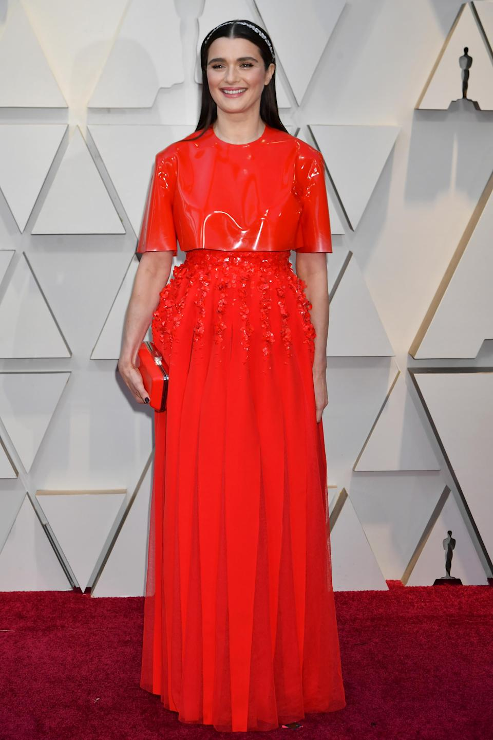 """<p>""""The Favourite"""" star and nominee for Best Supporting Actress wore a bright red gown with delicate flower detailing by Givenchy. <em>[Photo: Getty]</em> </p>"""