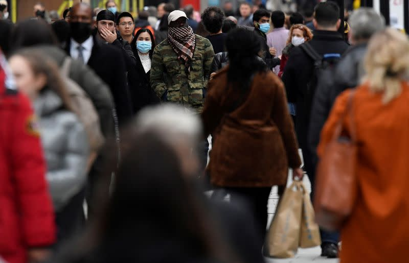 FILE PHOTO: Shoppers walk along Oxford Street, in the centre of London's retail shopping area, amid the spread of the coronavirus disease