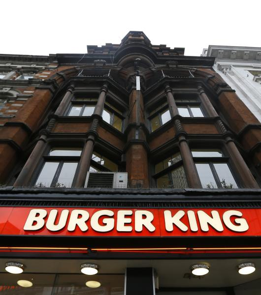 A sign above a branch of Burger King in central London, Thursday, Jan. 24, 2013. Burger King says it has stopped buying beef from an Irish supplier whose patties in Britain and Ireland were found to contain traces of horsemeat. Officials say there is no risk to human health, but the episode has raised food security concerns. (AP Photo/Kirsty Wigglesworth)