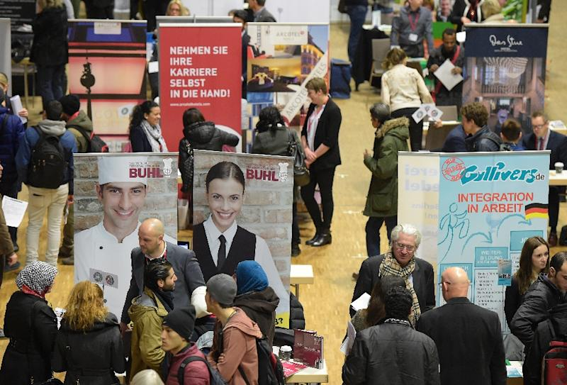 Visitors attend a job fair for migrants in Berlin on February 29, 2016 (AFP Photo/Tobias Schwarz)