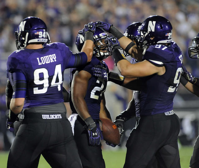 Northwestern's Ibraheim Campbell (24) celebrates with teammates after he made an interception in the second half of an NCAA college football game against Syracuse in Evanston, Ill., Saturday, Sept. 7, 2013. (AP Photo/Matt Marton)
