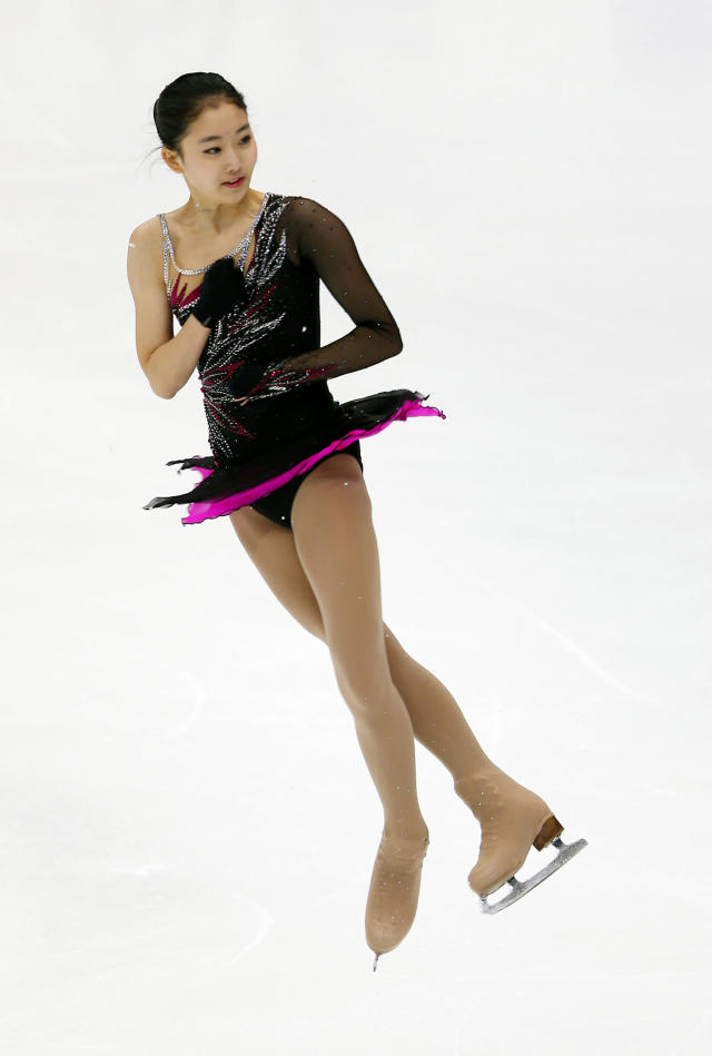 China's Li Zijun performs during the ladies short program of the Four Continents figure skating championships in Taipei, Taiwan, Thursday, Jan. 23, 2014. (AP Photo/Chiang Ying-ying)