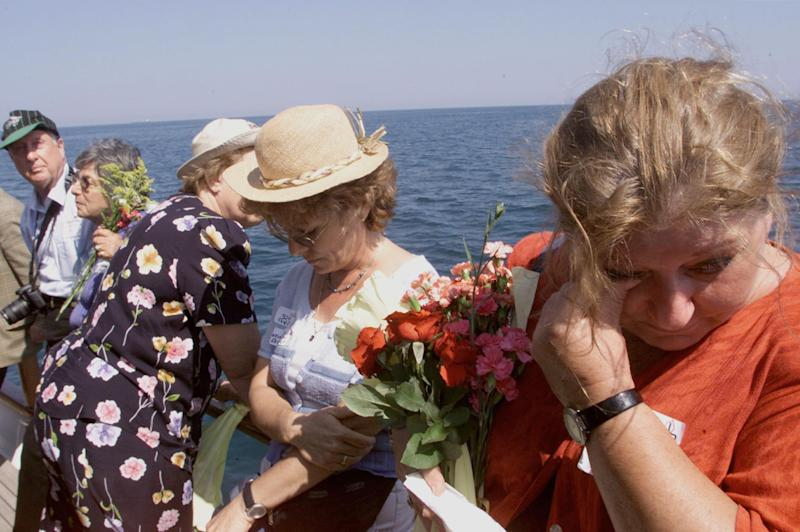 FILE - In this Sept. 3, 2000 file photo, relatives of the Struma victims mourn during a memorial service off the coast of Istanbul, Turkey,  At a time when Turkey welcomes Syrians fleeing violence, the anniversary Friday of the deaths of more than 750 Jewish refugees whose boat was abandoned by Turkish officials in World War II was a reminder of the tension between pragmatic and humanitarian impulses. The 1942 fate of the SS Struma, a ship trying to carry the refugees from Romania to Palestine, is a stain on Turkey's upbeat narrative of the Jewish experience in the mostly Muslim country. (AP Photo/Murad Sezer/Pool, File)